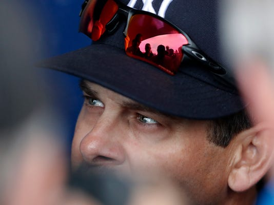 New York Yankees manager Aaron Boone speaks with reporters in the dugout before a spring training baseball game against the New York Mets, Wednesday, March 7, 2018, in Port St. Lucie, Fla. (AP Photo/John Bazemore)