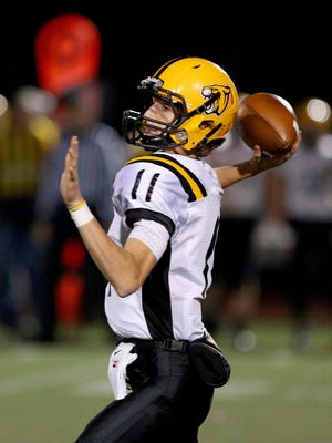 Cascade quarterback John Schirmer (11) passes the ball against Philomath during the quarterfinals of the OSAA Class 4A state playoffs, Friday, November 13, 2015, at Corvallis High School in Corvallis, Ore.