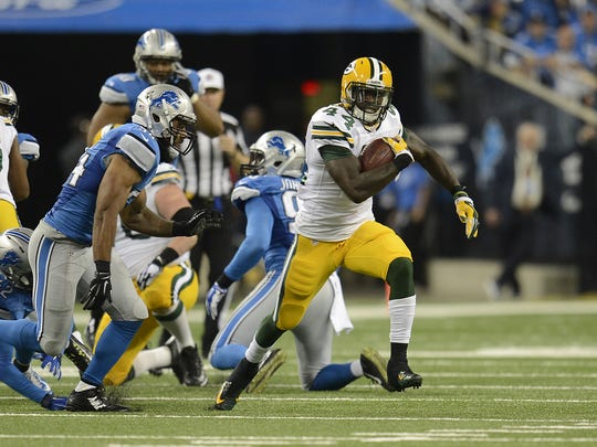 Green Bay Packers running back James Starks carries the ball against the Detroit Lions at Ford Field in Detroit on Sept. 21.