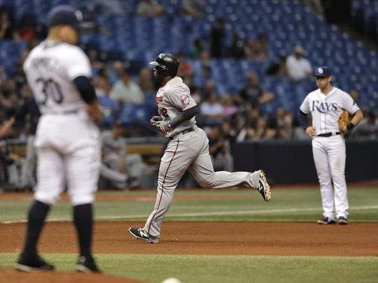 Tampa Bay Rays reliever Erasmo Ramirez, left, and third baseman Evan Longoria, right, look on as the Minnesota Twins' Miguel Sano circles the bases after hitting a solo home run during the eighth inning Friday in St. Petersburg, Fla.