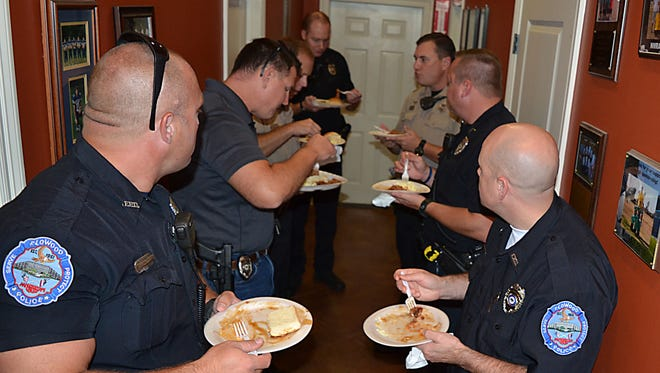 """Last year, officers with the Flowood Police Department and Rankin Sheriff?s Department enjoy a free lunch as part of the """"Blue Lives Matter"""" law enforcement appreciation luncheon."""