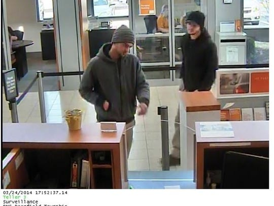 Surveillance footage of the two alleged PNC Bank robbers in Deerfield Township.