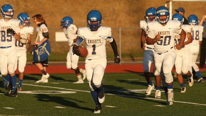 The Bremerton Knights take to the field at Silverdale Stadium Thursday before their season opener against Klahowya.