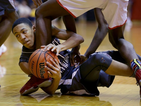 Lawrence Central's Nijel Pack (21).