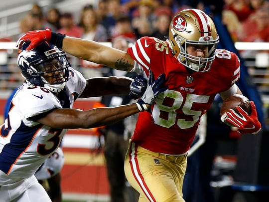 San Francisco tight end George Kittle runs past Denver Broncos safety Orion Stewart on a touchdown reception on Aug. 19 in Santa Clara, Calif.