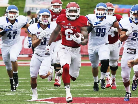 Tevin Coleman leads a gang of would be ISU tacklers
