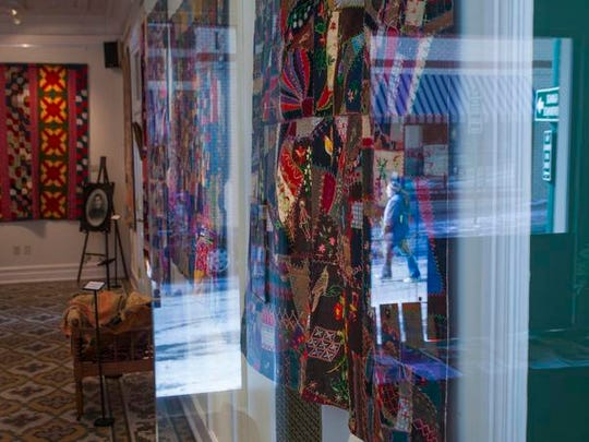 Quilts are displayed inside the R.R. Smith Center for