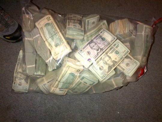Hundreds of thousands of dollars were seized during