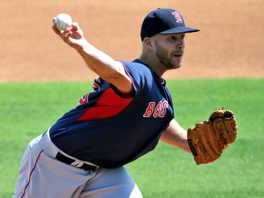 Boston Red Sox starting pitcher Justin Masterson (63) delivers in the first inning of a spring training baseball game against the Philadelphia Phillies in Clearwater, Fla., Sunday, March 15, 2015. (AP Photo/Kathy Willens)