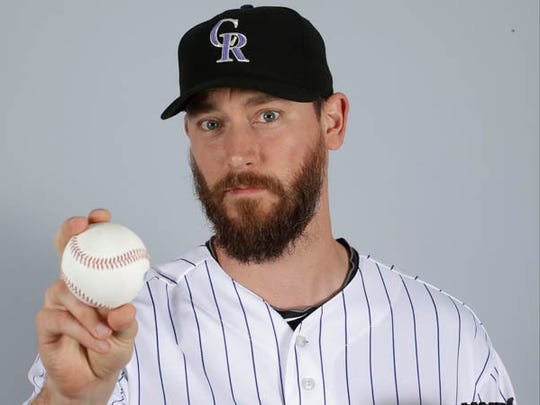"FILE - In a March 2015 file photo, John Axford of the Colorado Rockies baseball team poses for a photo in Scottsdale, Ariz. Axford's 2-year-old son is improving following a rattlesnake bite. Jameson Axford remained hospitalized for an eighth straight day, but Axford said Wednesday, Apri his son was able to sleep through the night as he deals with pain. Doctors have saved his right foot, but there is fear one of his toes may need to be amputated. ""It's looking better,"" Axford said. ""We're going by doctors' orders. They know more than we do. We're going to trust them to heal him the best way possible."" (AP Photo/Darron Cummings, File)"