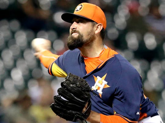 Houston Astros reliever Pat Neshek delivers a pitch against the Kansas City Royals in the eighth inning of an exhibition baseball game Friday, April 3, 2015, in Houston. (AP Photo/Pat Sullivan)