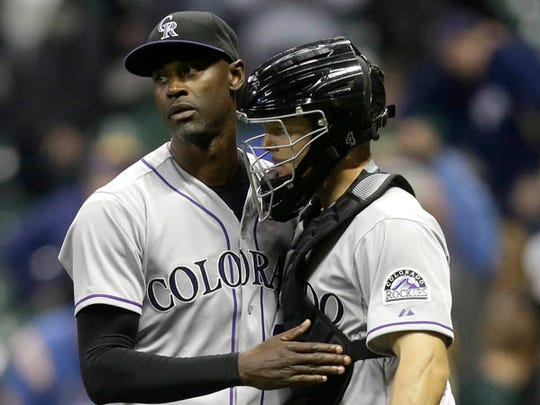 LaTroy Hawkins #32 of the Colorado Rockies celebrates with Nick Hundley #4 after the 5-2 win over the Milwaukee Brewers at Miller Park on April 7, 2015 in Milwaukee, Wisconsin.