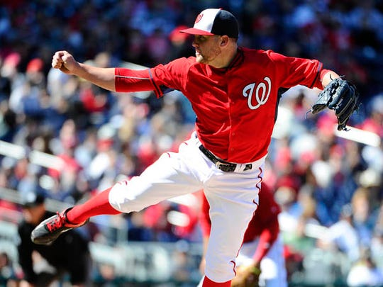 Washington Nationals relief pitcher Drew Storen (22) throws against the New York Yankees during the eighth inning at Nationals Park.