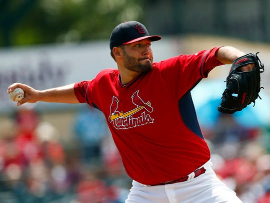 St. Louis Cardinals starting pitcher Lance Lynn (31) throws in the first inning of an exhibition spring training baseball game against the New York Mets Thursday, April 2, 2015, in Jupiter, Fla. (AP Photo/John Bazemore)