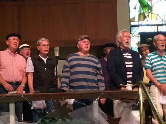 """Men of SongShine singing a tune from """"Carousel."""""""