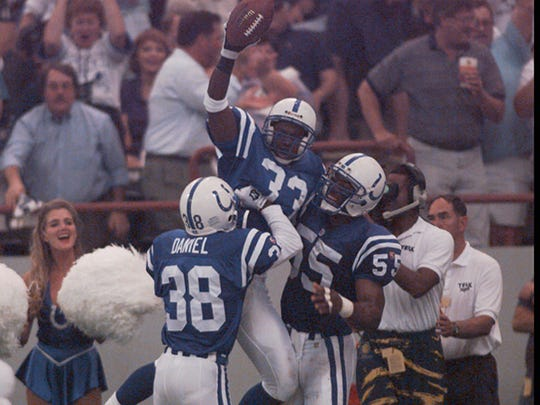 Ashley Ambrose (center) had a better career as a Bengal than a Colt.