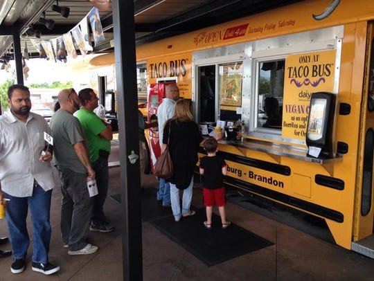 Customers line up at Taco Bus on the day of the reveal