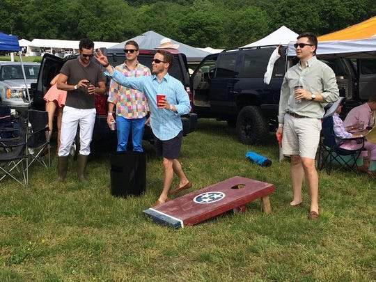 Zach Hughes and Shane Clore played cornhole at the