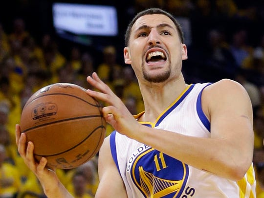Golden State Warriors' Klay Thompson (11) drives to