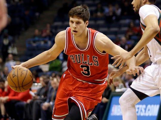 Chicago Bulls' Doug McDermott dribbles against Milwaukee