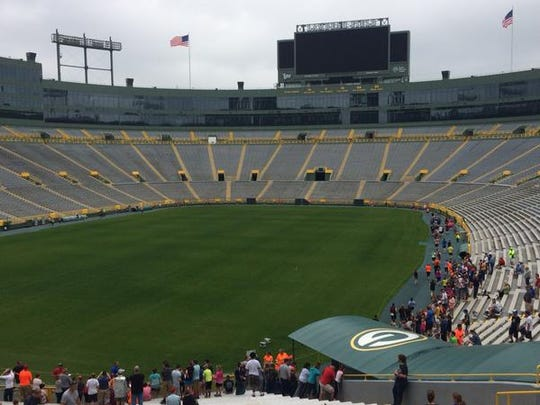 It wasn't game day at Lambeau Field on Sunday, but there were plenty of cheers and high-fives for Cellcom Green Bay Marathon runners exiting and entering the Packers' tunnel. They take a lap around the field.