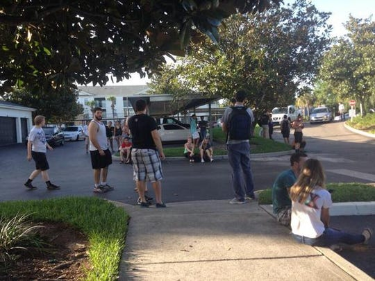 Residents of Arden Villas evacuating the buildings.