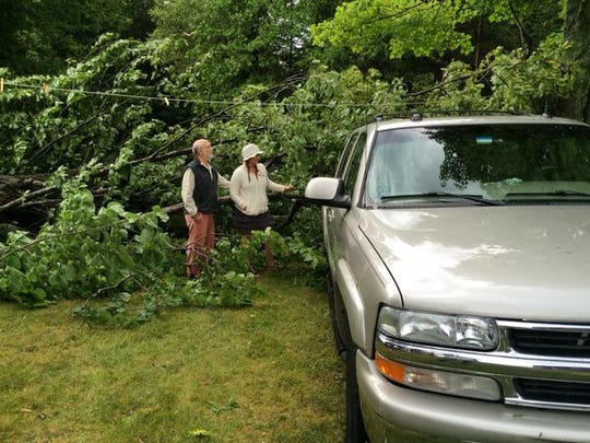 Tom and Liz Torinus survey damage at their Egg Harbor summer home. The family is stranded, all exits are blocked.