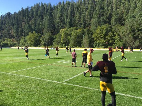 ASU running back De'Chavon Hayes (1) and the Sun Devils