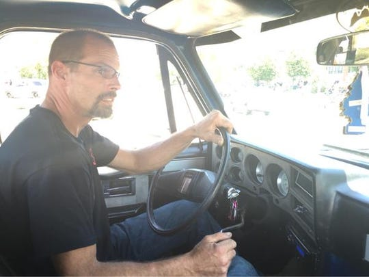 John Guilds takes his 1985 Chevrolet Silverado for a spin in Pontiac during the Dream Cruise.