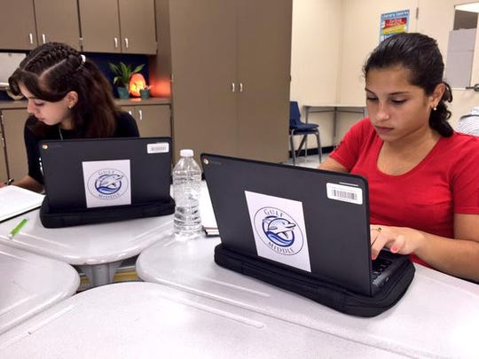 Gulf Middle School students work on their Chromebooks at school.