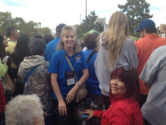 Lisa  Plummer, center left, and Pat Fierro.