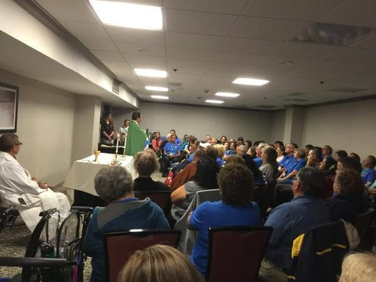 The Rev. Tony Celino presided at Mass in a hotel conference