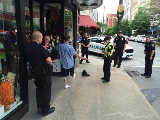 Members of the Asheville-Buncombe DWI Task Force have a suspect take a sobriety test downtown in this file photo.