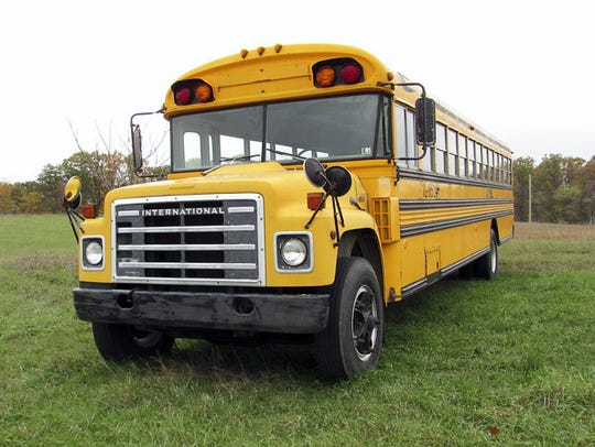 The buses that Camp Joy El uses to transport students