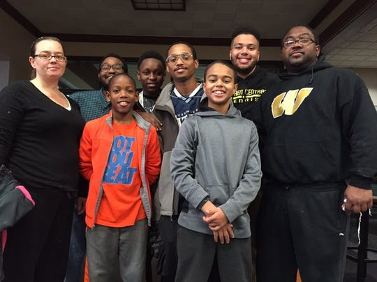 David Pierson (right), his wife, Jennifer, and their sons and nephews volunteered at the Mozel Sanders Thanksgiving Dinner on Thursday, Nov. 26, 2015, at Butler University. Also shown are David Pierson III, 12; Damin Pierson, 19; Jeivan Ross, 12; Isaiah Pierson, 25; Devonte Banks, 21; and Eris Page, 14.