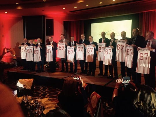 Rutgers' 1967 team holds up commemorative jerseys Friday