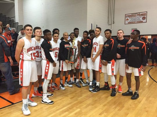 The Northeastern boys' basketball team poses after winning the Bobcats' tip-off tournament title on Saturday.