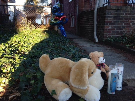 Stuffed animals, candles and other items were left at Dennison's home to remember the teen.