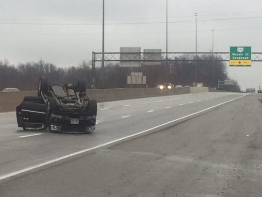 A car sits on its top on U.S. 30 eastbound following