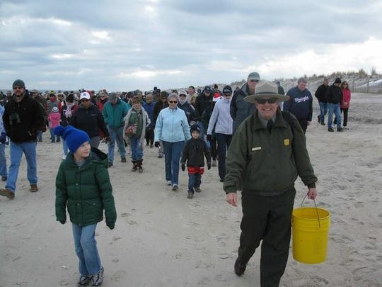 Rangers lead a First Day Hike at Assateague State Park