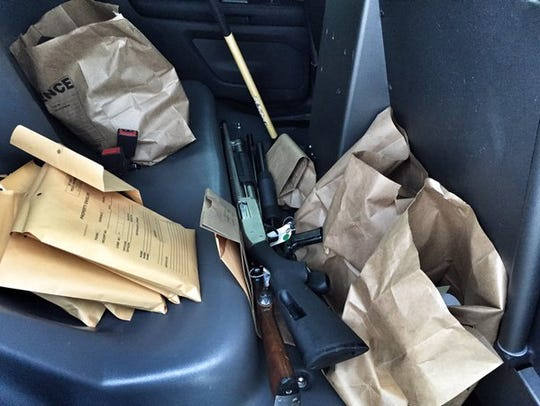 """Police recovered 17 weapons from the """"getaway"""" car"""