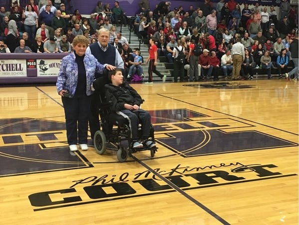Mitchell named its basketball court for former coach Phil McKinney on Friday in Ledger.
