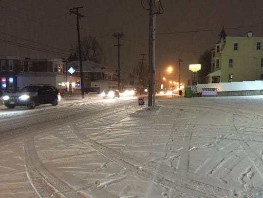 Snow accumulates on North George Street in North York