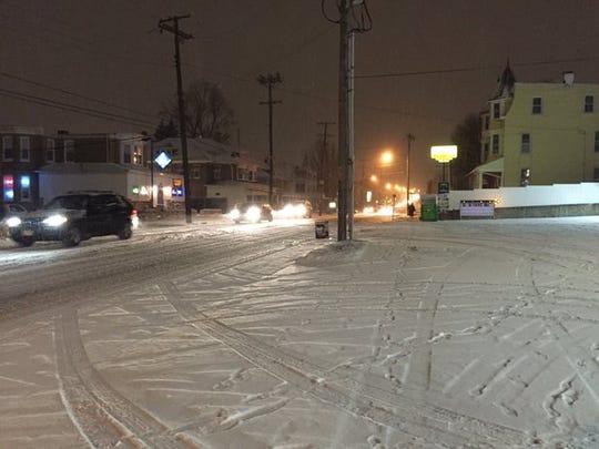 Snow accumulates on North George Street in North York
