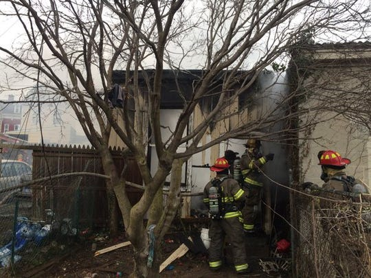 A garage fire destroyed one garage and one vehicle Sunday morning.