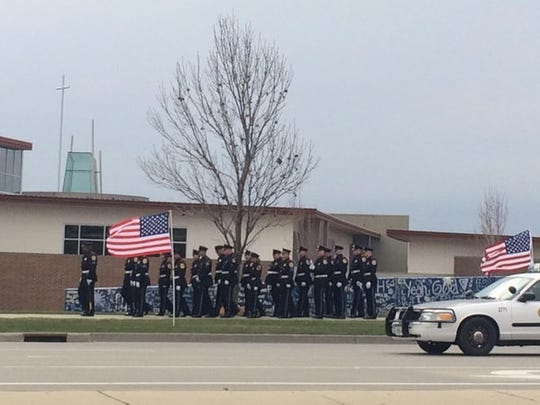 Officers with the Des Moines Police Department line up outside Lutheran Church of Hope on Jordan Creek Parkway in West Des Moines on Wednesday, March 30, 2016, in advance of the funeral for Officer Susan Farrell, who was killed in a wreck Saturday.