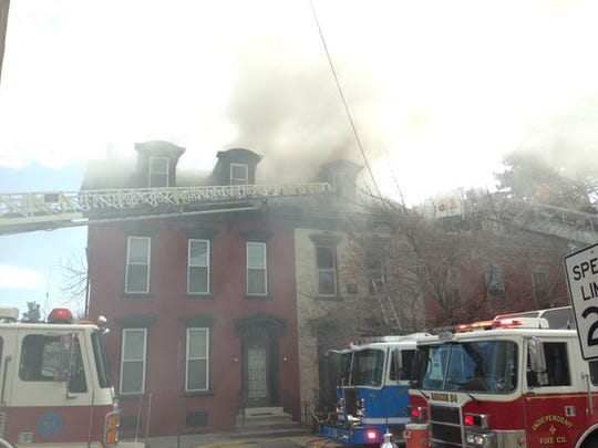 Heavy smoke comes from the buildings at the structure