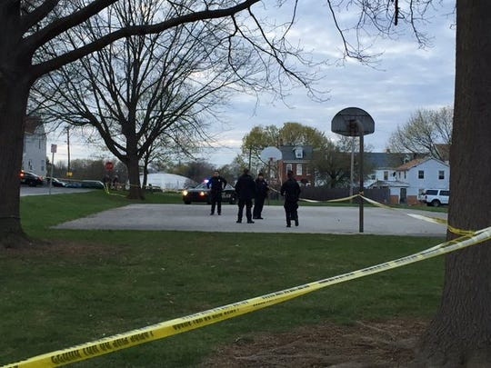York City Police cordon off an area where a shooting occurred on East Maple Street.