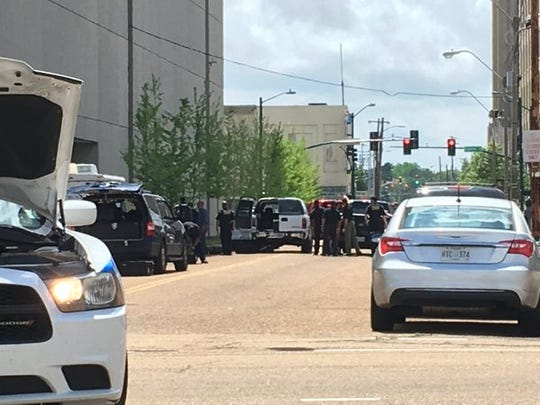 The bomb squad prepares to detonate a suspicious package behind the McCoy Federal Building in Downtown Jackson.
