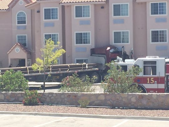 A semi-truck on Friday struck a Studio 6 motel on the West Side, killing one man and sending the truck driver to a hospital.
